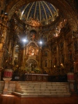 Altar in La Iglesia de San Francisco. There are three parts to it: the baptism of Jesus (top), the almighty Jesus (bottom), and the Virgin of Quito (middle) which is what El Panecillo is modeled after.